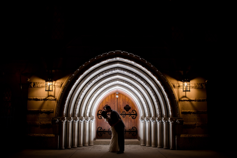 night photo of bride and groom outside