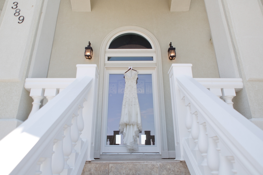 wedding dress hanging from doorway