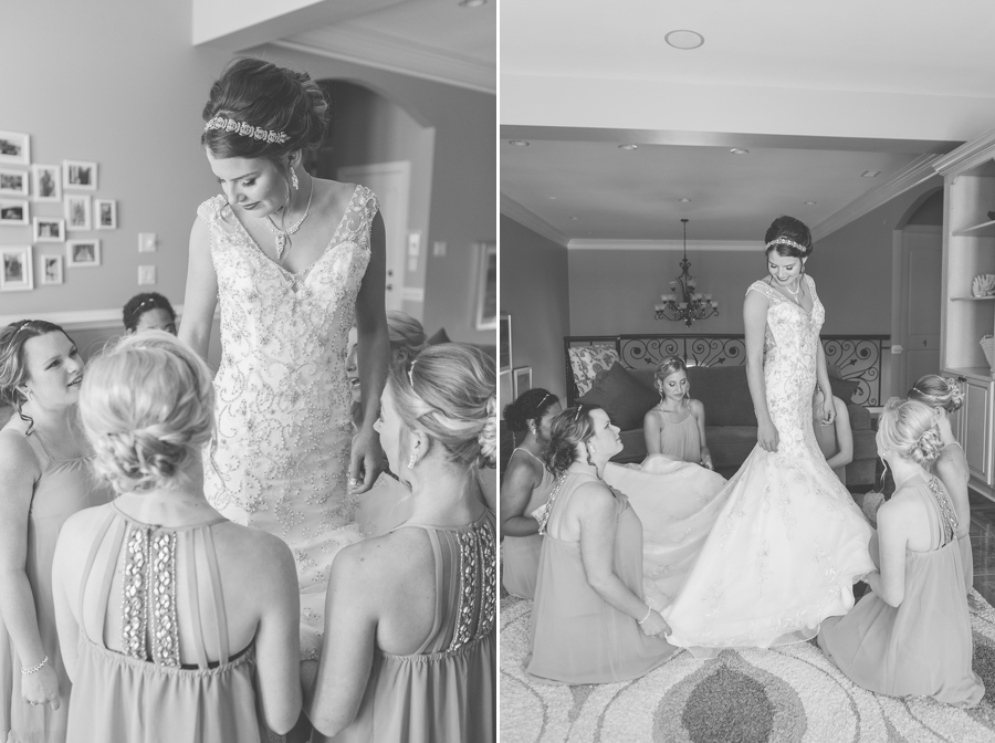 bridesmaids adjusting brides wedding gown