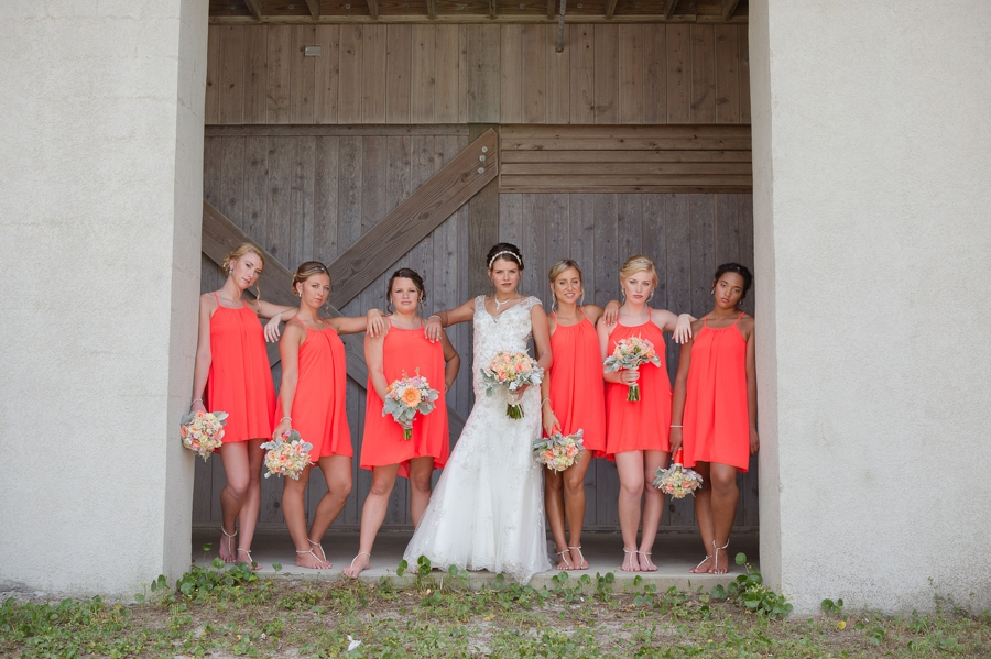 bride and bridesmaids posing at ocean isle wedding