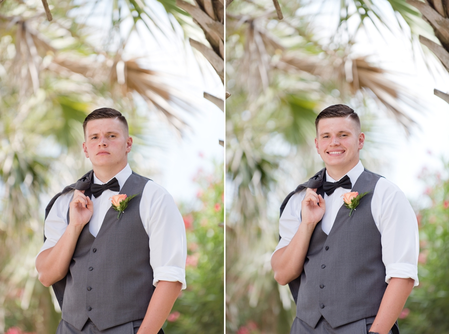 groom smiling with palm tree at ocean isle beach wedding