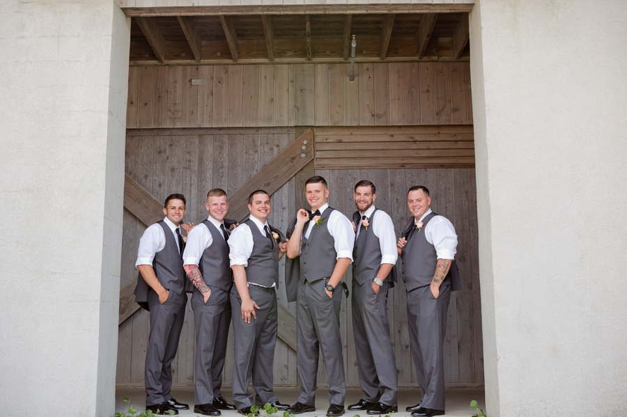groom with groomsmen smiling at ocean isle wedding