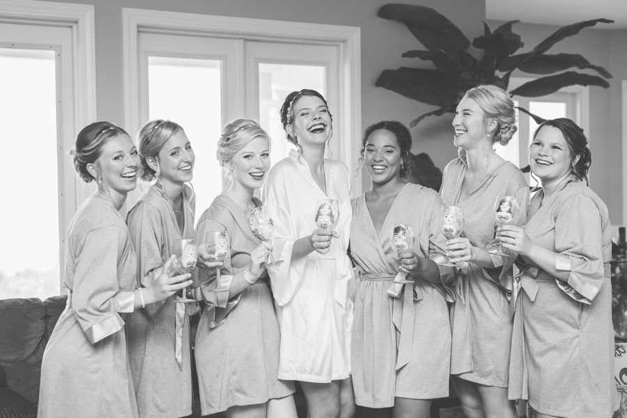 bridesmaids cheering with champagne