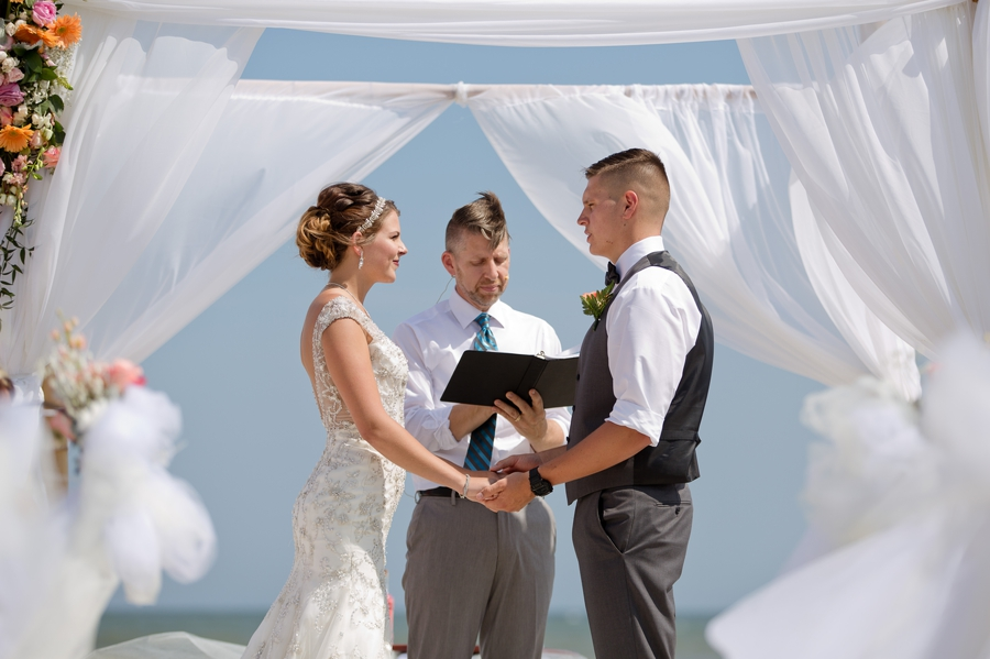 groom saying wedding vowels