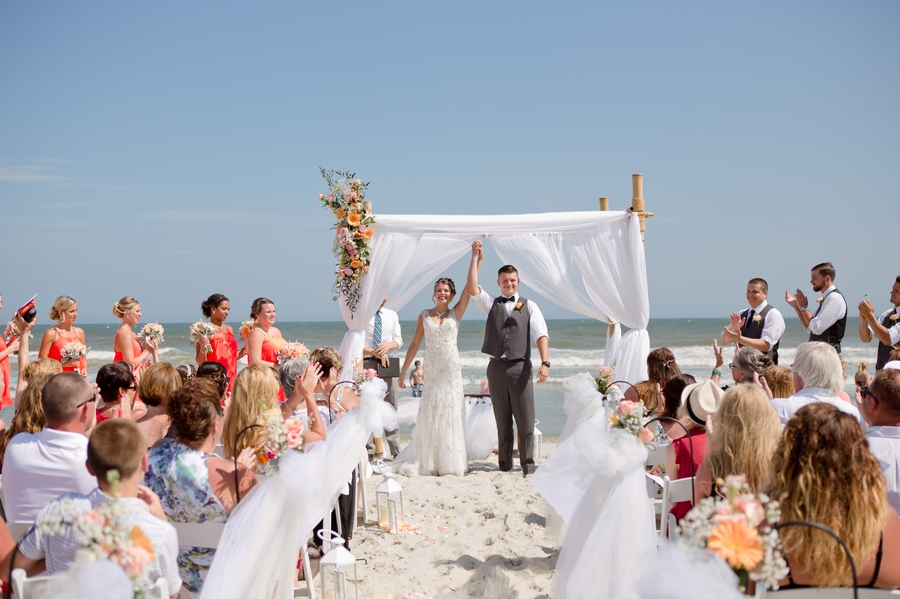 announcement of married couple on beach