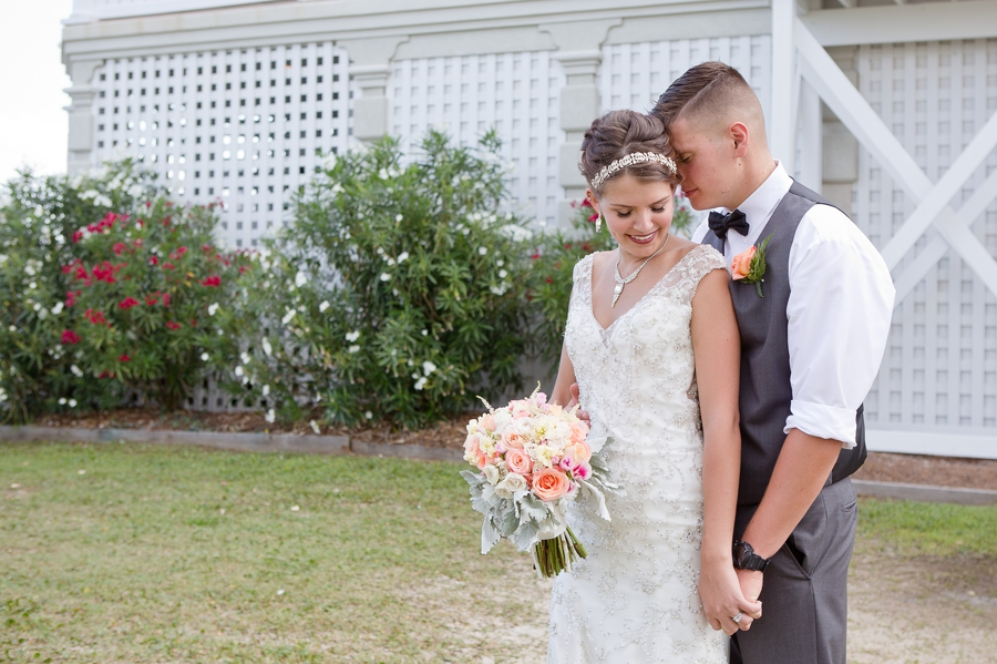 groom whispering in brides ear at ocean isle beach wedding