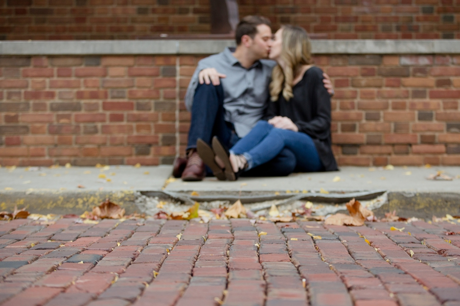 brick paved road on Ohio University campus with couple kissing