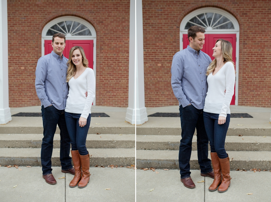engaged couple in front of red door on Ohio University campus