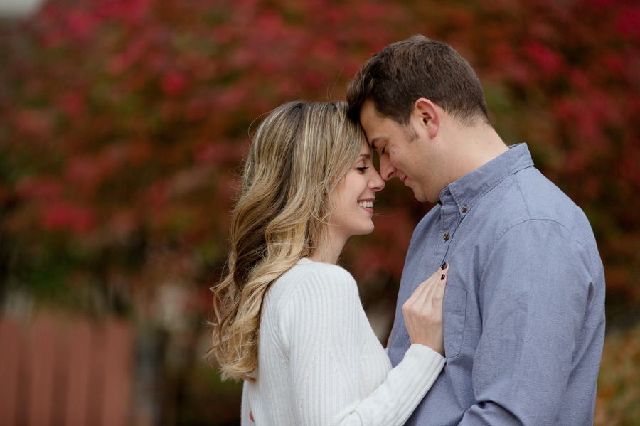 engaged couple with foreheads together at Ohio University engagement