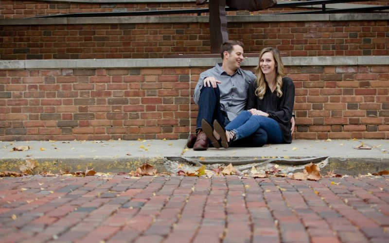 groom laughing at bride to be at Ohio University engagement