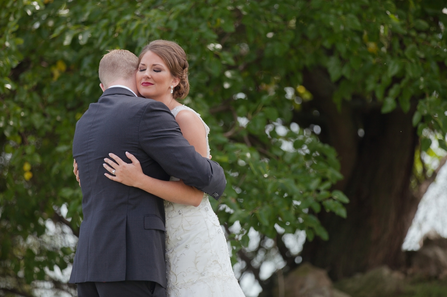 couple hugging during first look