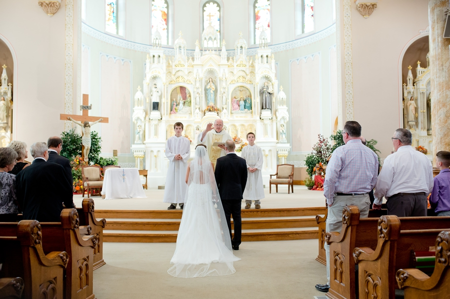 bride and groom at alter at immaculate conception parish