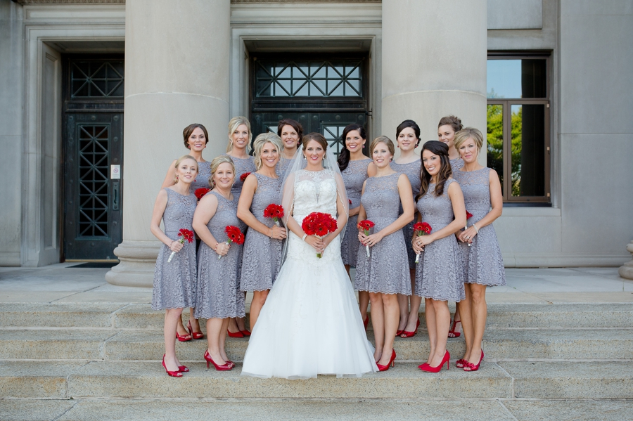 bride and bridesmaids on stairs at the galleria