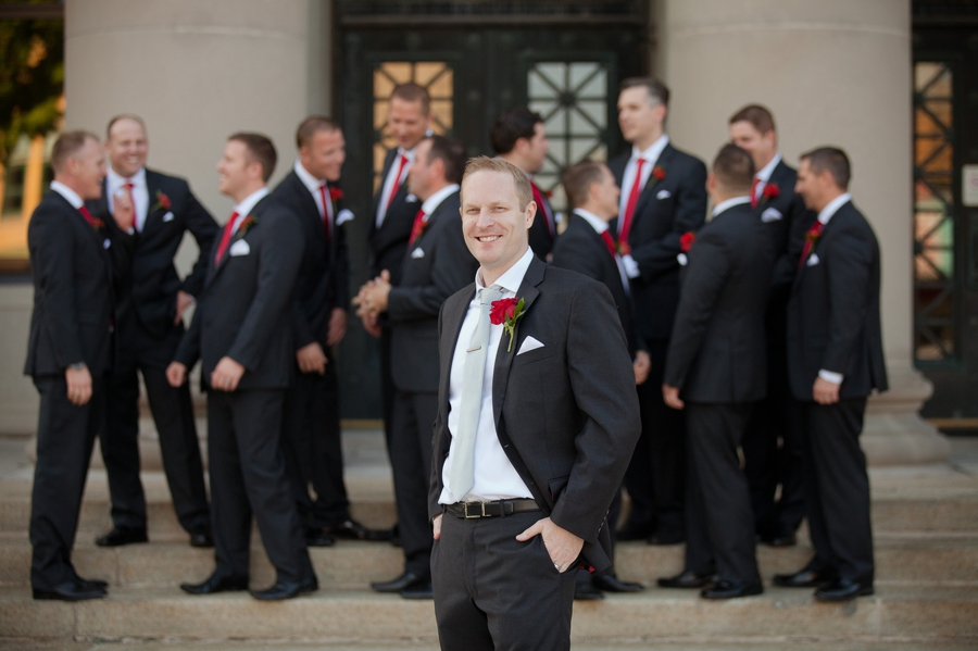 groom with groomsmen in background at the galleria in celina ohio