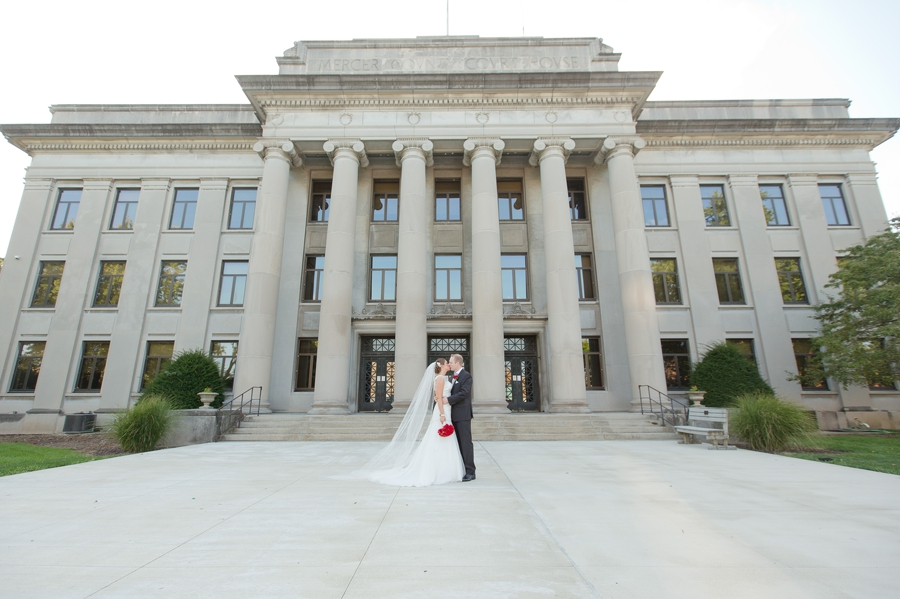 wide photo of bride and groom kissing in celina ohio