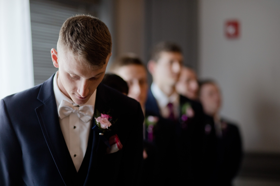 grrom waiting for bride to walk down aisle