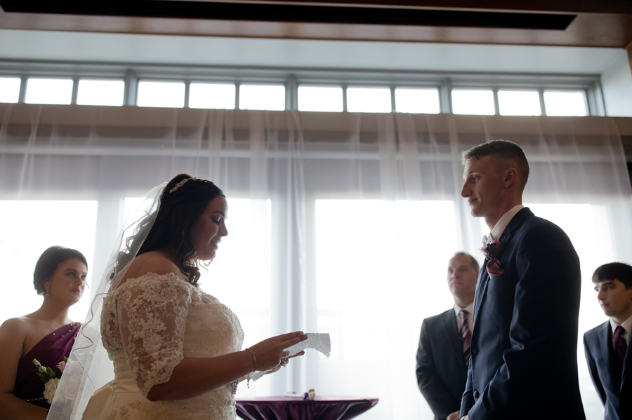 bride reading vows during ceremony