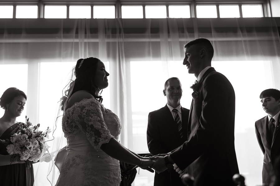 black and white photo of bride and groom at Noah's Event Venue wedding ceremony