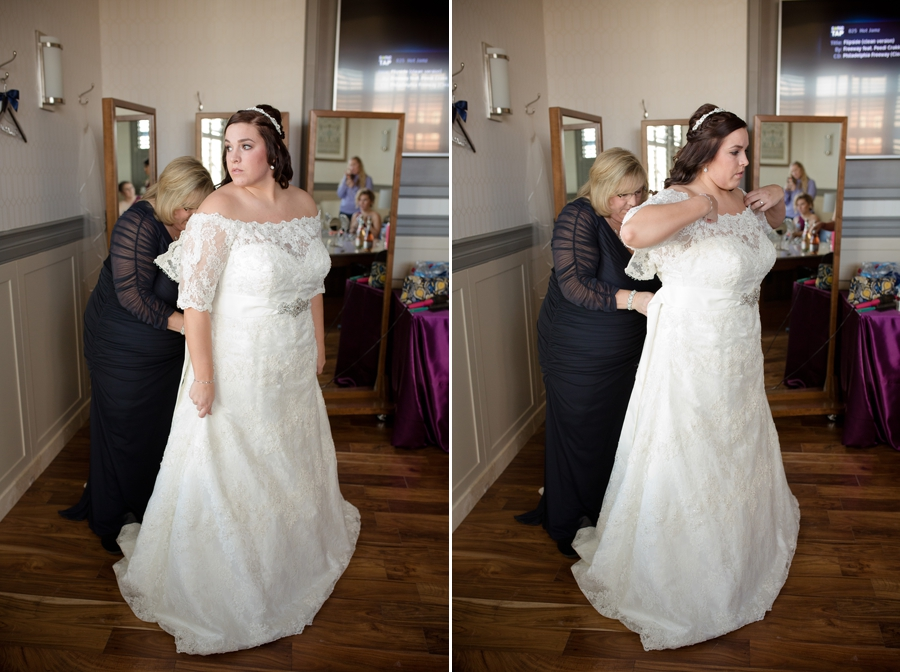 bride getting into wedding gown