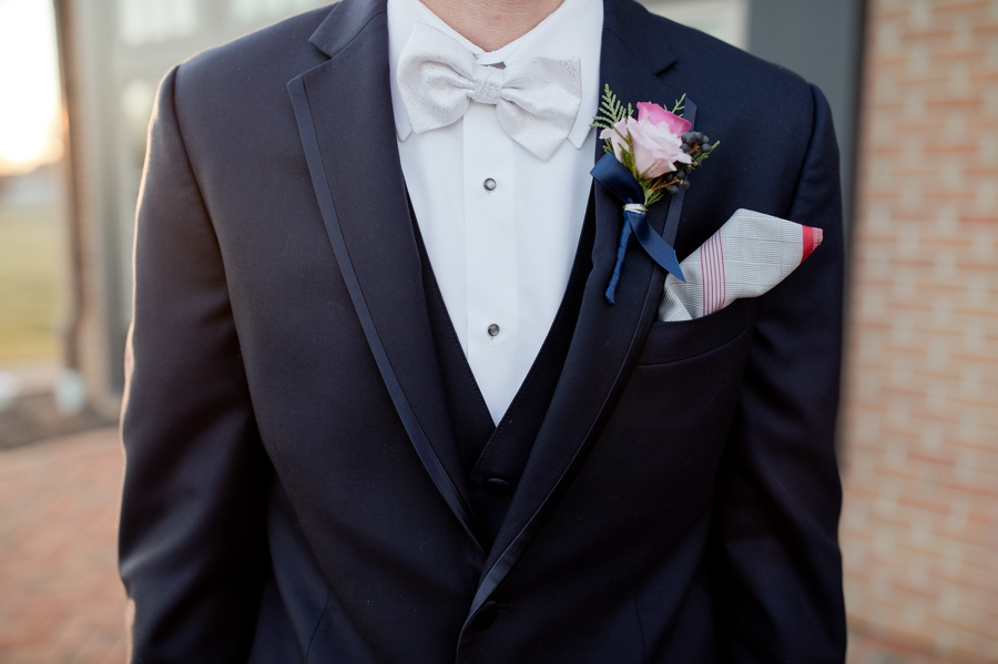 close up of grooms navy colored suit