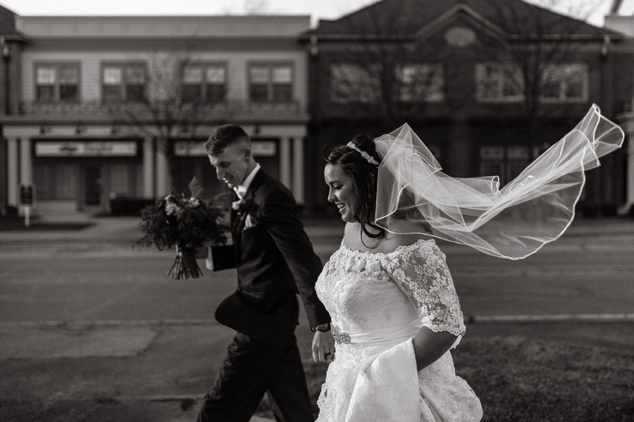 black and white photo of brides veil blowing