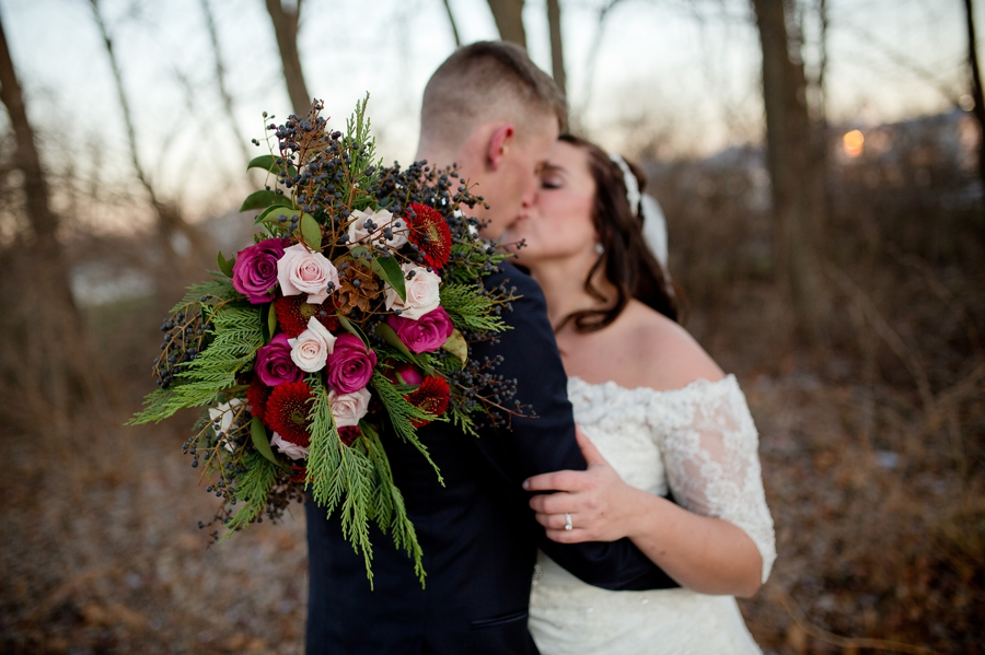 bouquet in fous with couple in background