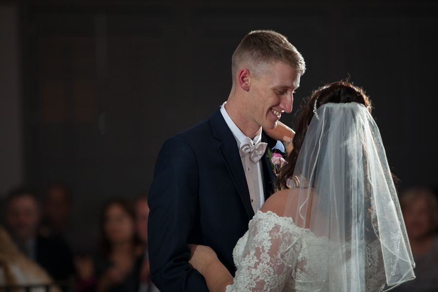 grrom looking at bride during dance