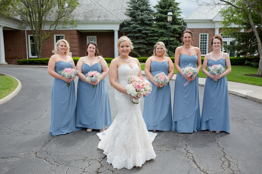 bride with bridesmaids in front of wedgewood country club