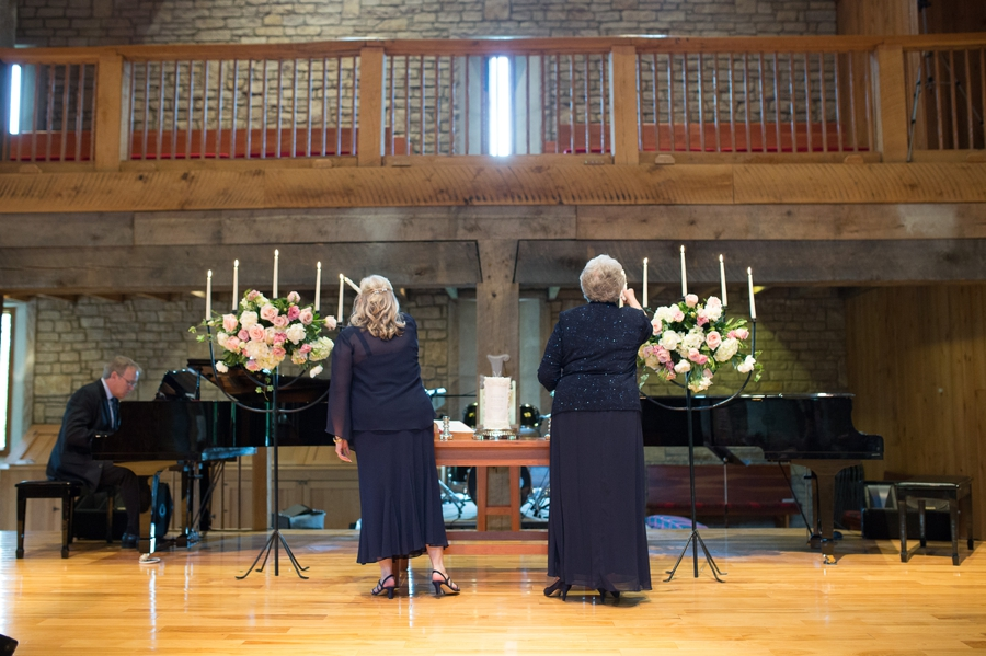 mothers lighting candles at wedding ceremony
