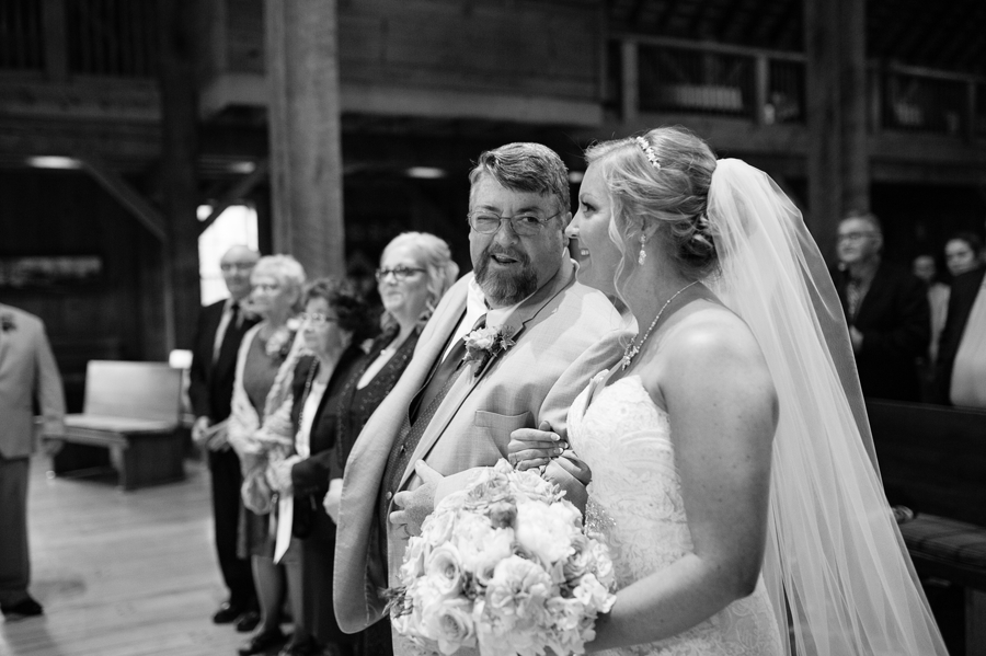 father of bride winking at bride
