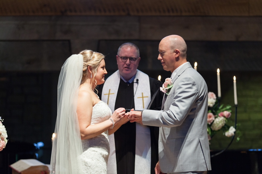 bride and groom exchanging rings at liberty presbyterian church