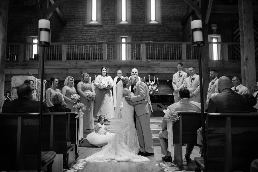 couple kissing for first time at wedding ceremony