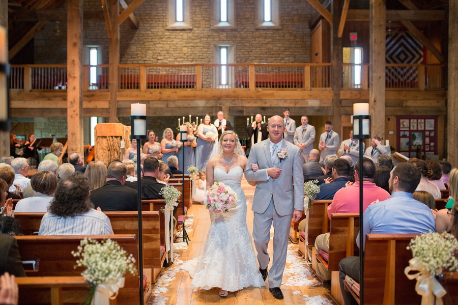 couple during recessional at wedding