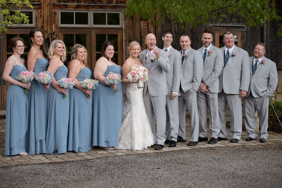 side angle photo of wedding party laughing