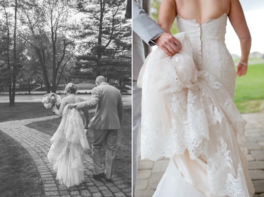 black and white photo of groom holding brides dress