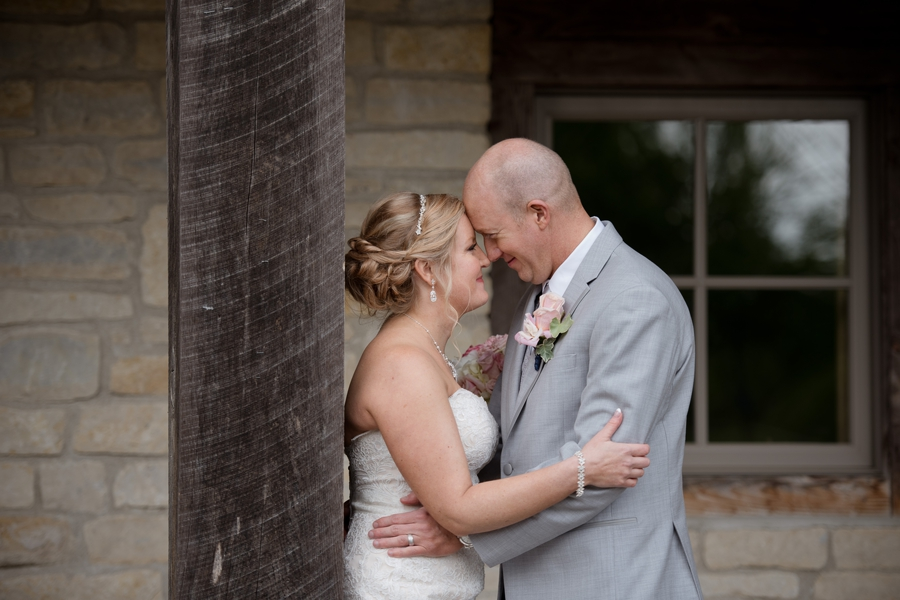 bride and groom with foreheads together