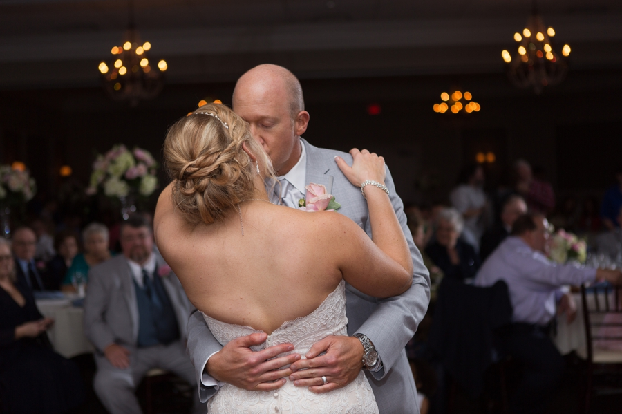 groom kissing bride during first dance