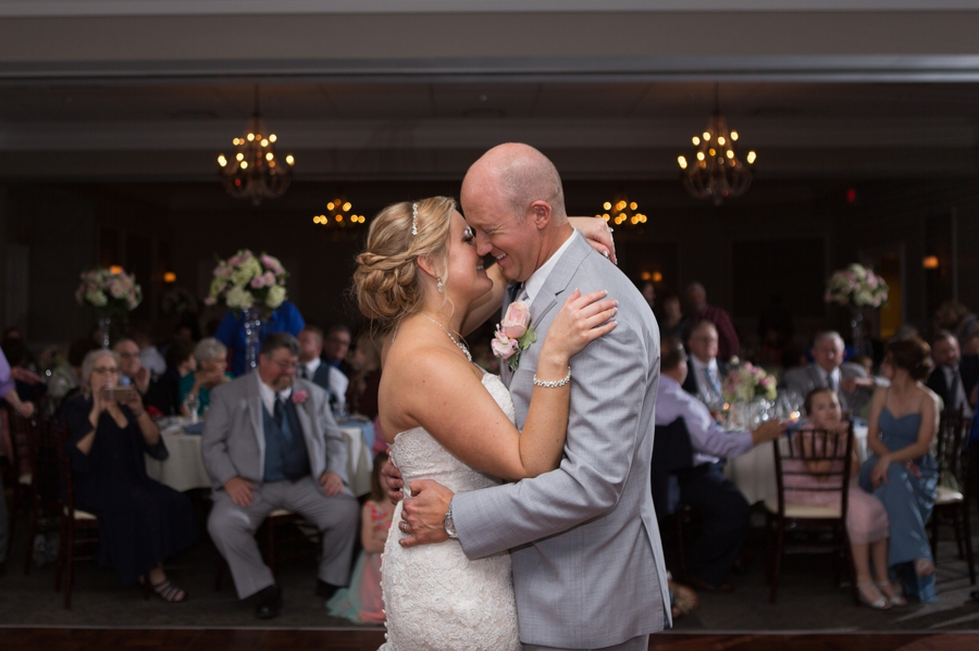 bride and groom laughing during first dance at wedgewood country club wedding