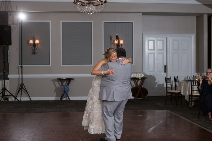 father of bride picking up bride during dance