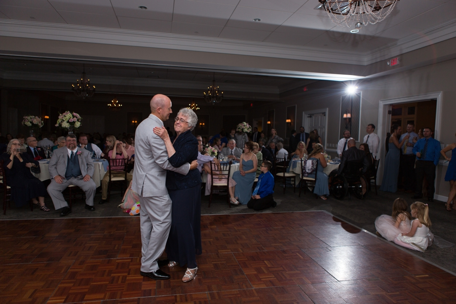 wide photo of mother son dance