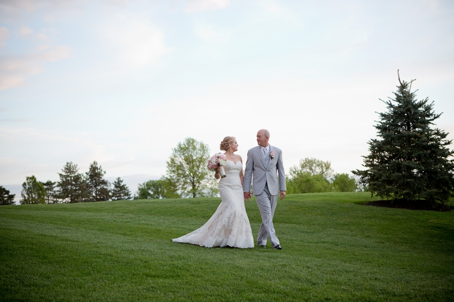 couple walking down a hill