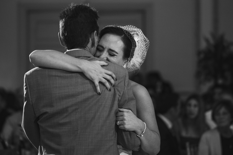 bride crying during father daughter dance