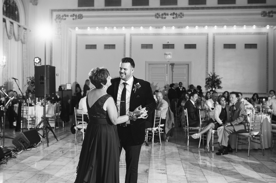 black and white photo of mother son dance