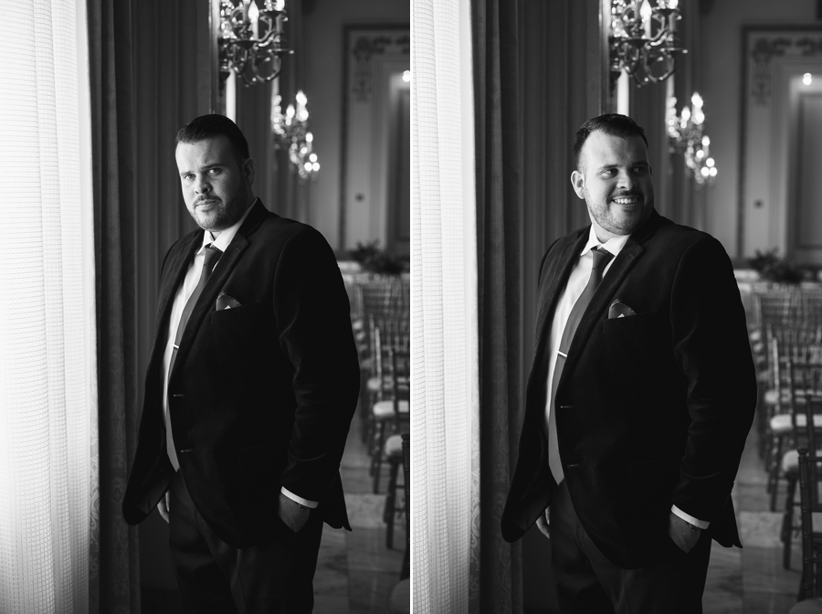 black and white photo of groom by window at the westin great southern