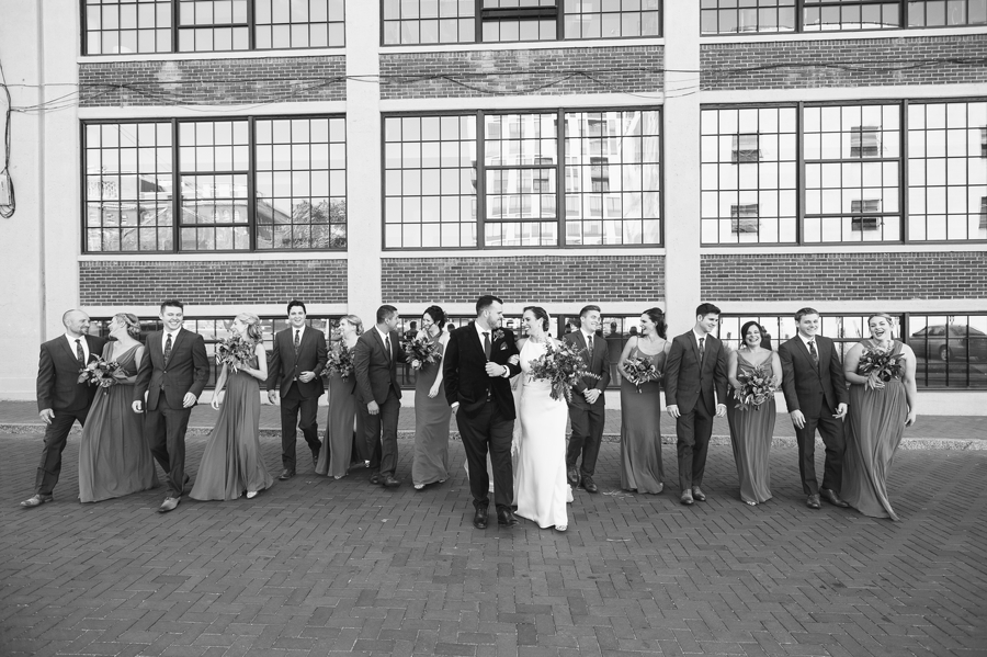 black and white photo of wedding party walking