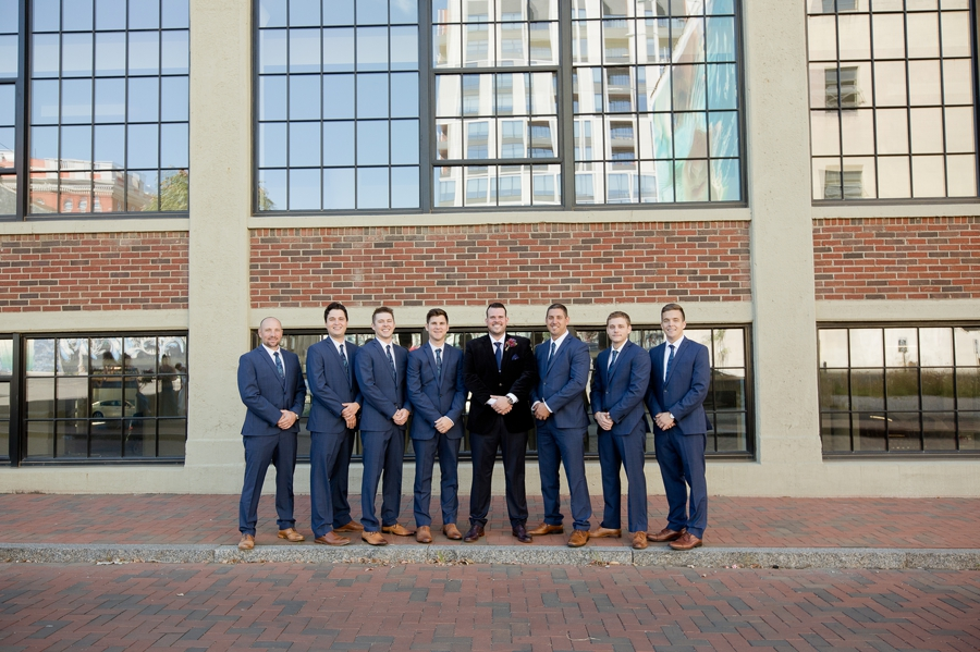 groom and groomsmen smiling at the westin