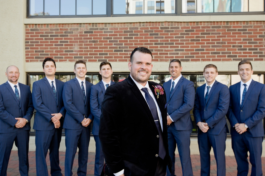 close up of groom with groomsmen in background at the westin columbus