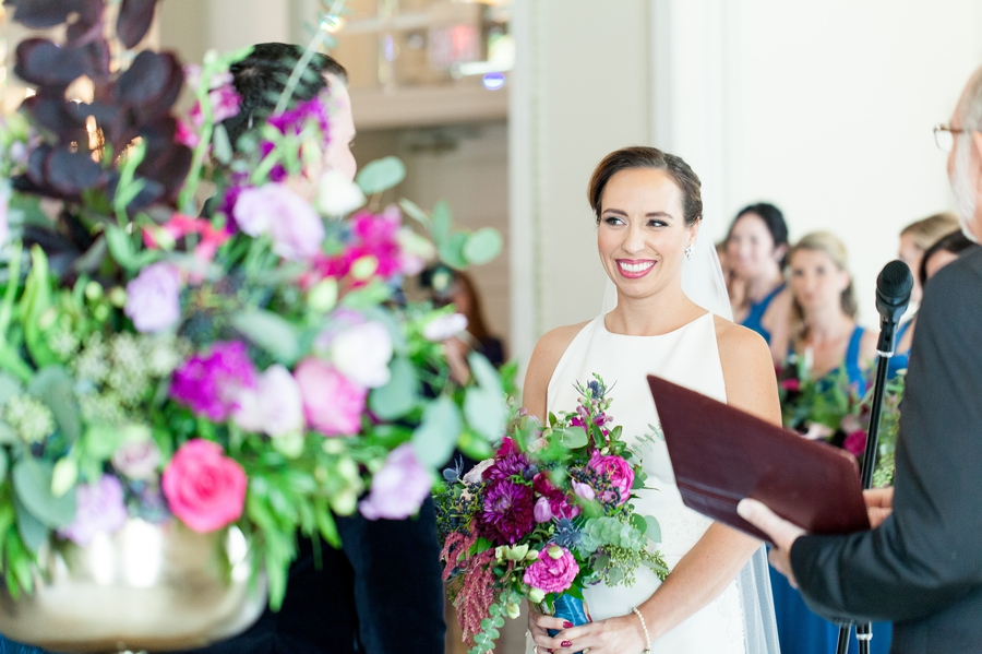 bride smiling at groom during wedding ceremony
