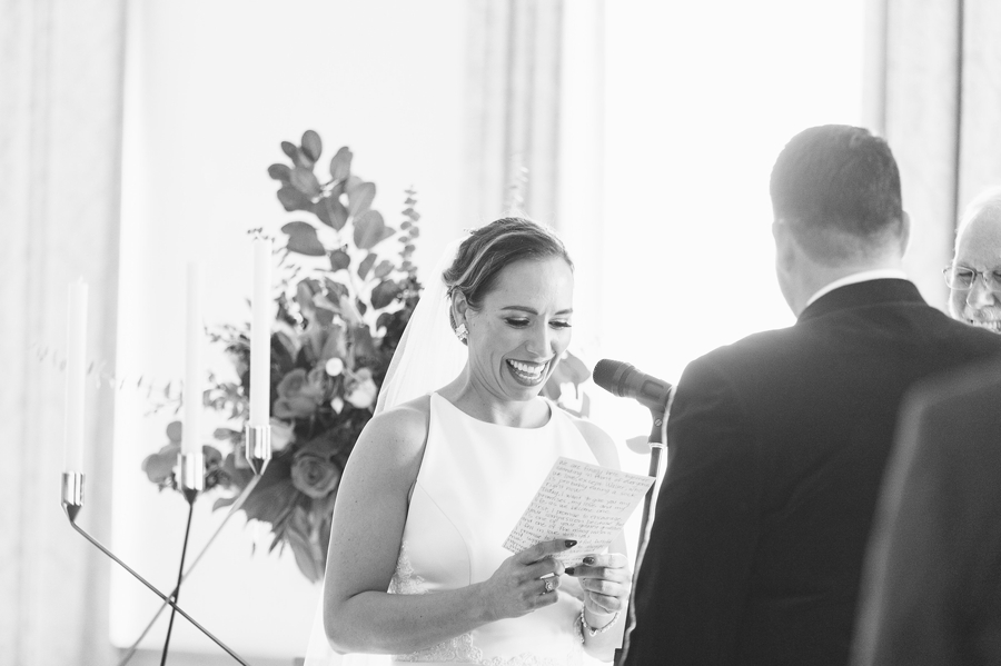 black and white photo of bride reading vowels