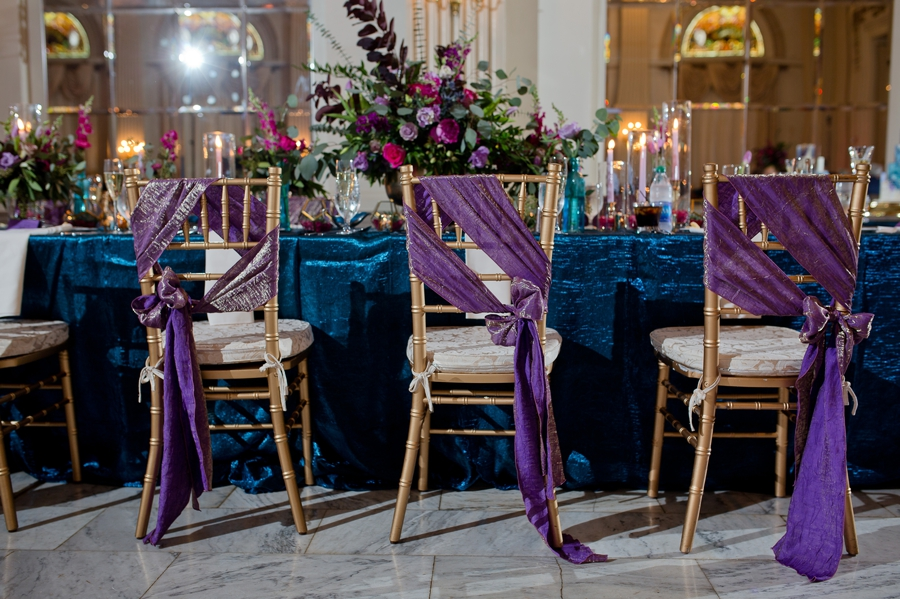 gold chairs with purple and gold sashes